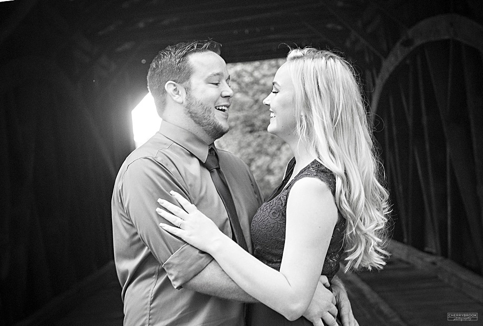 Engagement Photographs of two smiling individuals.