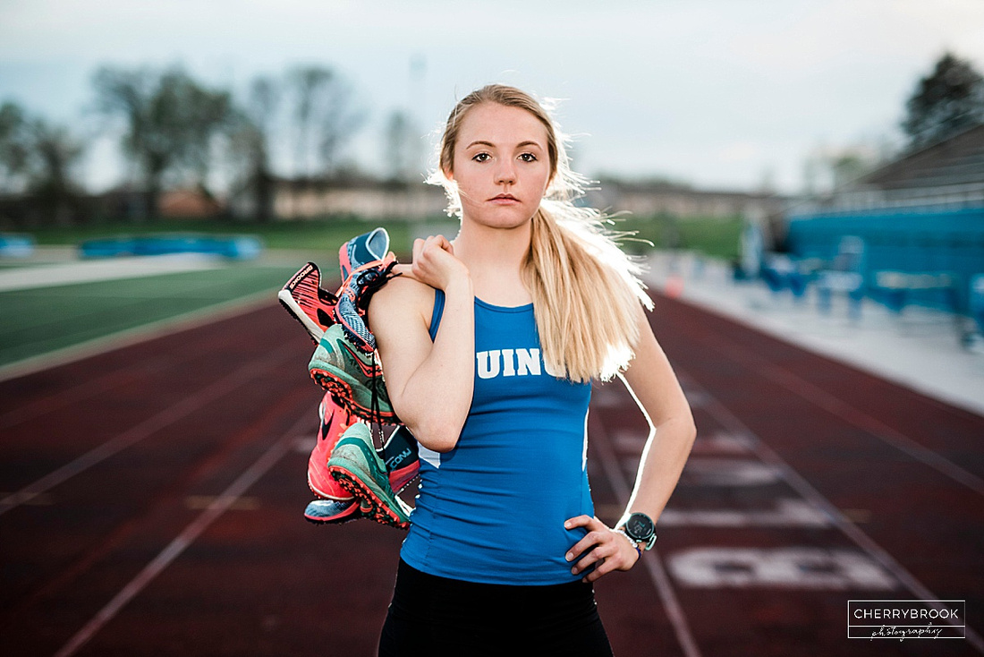 Senior Portrait Session Featuring a Track and Field Theme