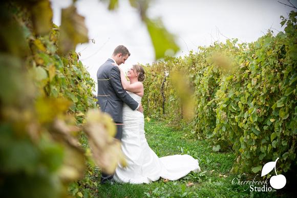 Bride and Groom in vineyard.
