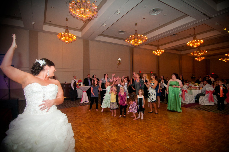 Bride throwing Boquete at Abraham Lincoln Hotel and Conference Center